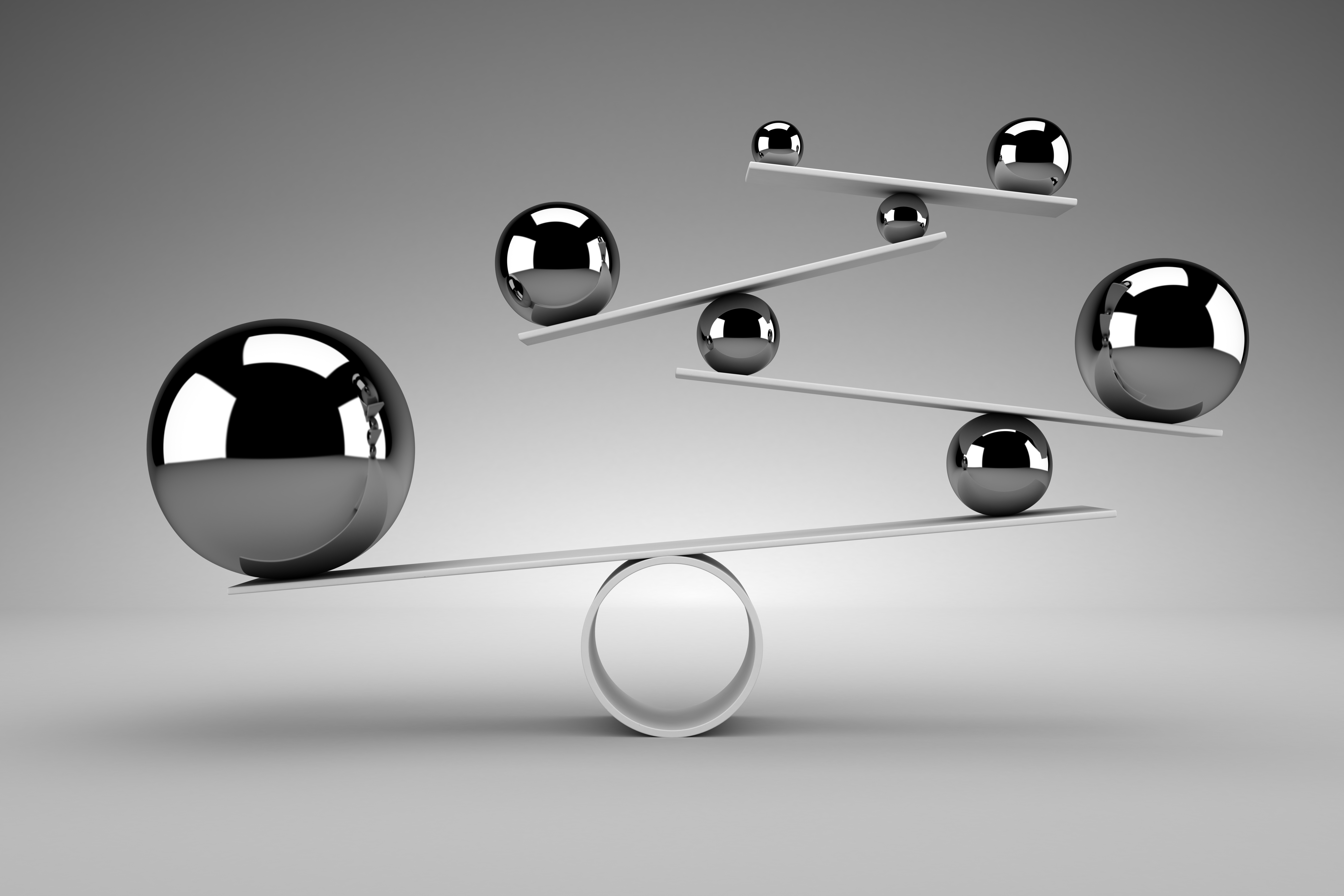 marbles on levers representing balance between accuracy and simplicity